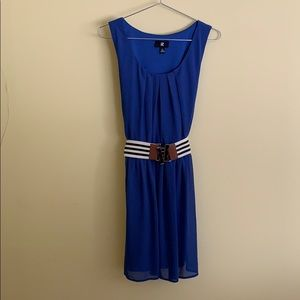 Blue dress with off-white and black striped belt.
